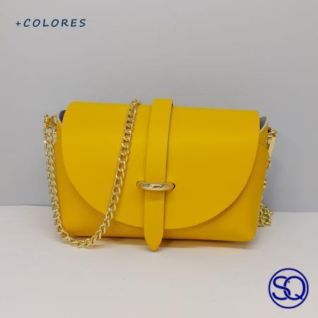 bolso piel baúl amarillo. Tocados y complementos Sagrario Quilez