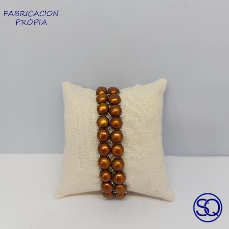 pulsera elástica de perlas cultivadas marrones. Tocado s y complementos Sagrario Quilez (1)
