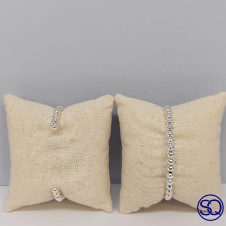 pulsera plata rígida de bolas de plata. Tocados y complementos Sagrario Quilez